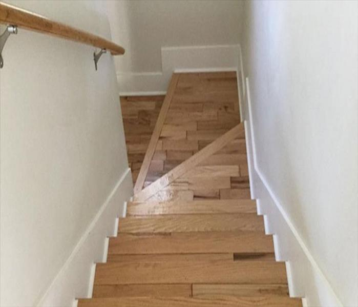 Water Damage to Stair Case in Dallas Before