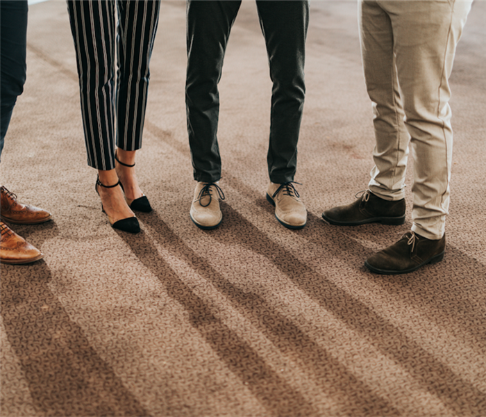 People in the office standing on carpet