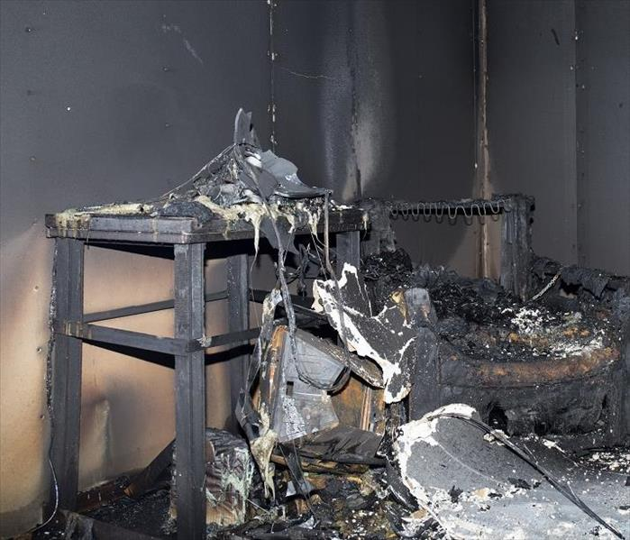 heavy  smoke and soot on fire damaged walls
