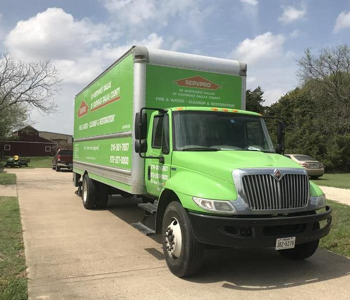 SERVPRO truck in a customers driveway.
