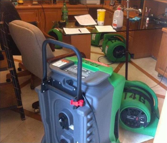 Our commercial air movers and dehumidifiers working to dry the materials in this property