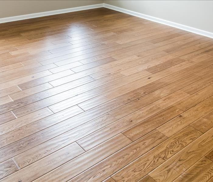 Is There A Way To Repair Water Damage To Wooden Floors Servpro Of