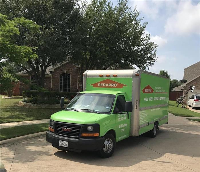 SERVPRO vehicle outside job site.