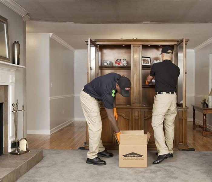 SERVPRO technicians packing items in a box